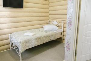 A bed or beds in a room at ApartHotel Pereslavskaya Sloboda