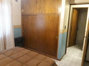 Una cama o camas en una habitación de Hospedate en departamento en Ciudad de Mendoza