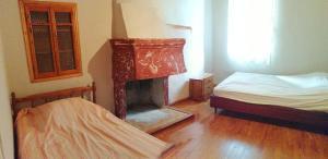 Ένα ή περισσότερα κρεβάτια σε δωμάτιο στο Vasaras