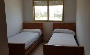 Cama o camas de una habitación en Principado Marina
