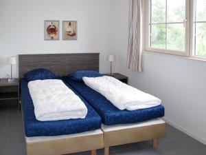 Een bed of bedden in een kamer bij Beach-Resort Makkum