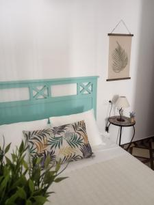 A bed or beds in a room at Casa Eva