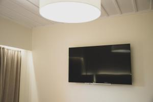 A television and/or entertainment center at Ammos Beachfront Luxury Rooms - Adults only