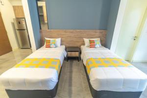Cama o camas de una habitación en OYO Home 935 Breathtaking Studio Imperio Residence