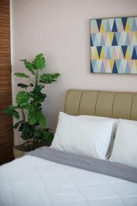 A bed or beds in a room at Cendana Villa