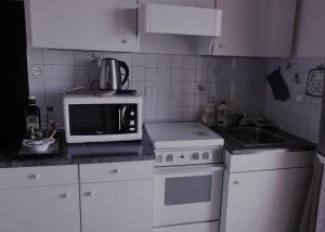A kitchen or kitchenette at Casa Franceska