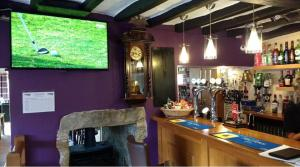 The lounge or bar area at Tyn-y-Capel apartment