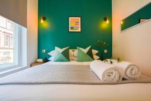 A bed or beds in a room at The Cultural Quarter Boutique