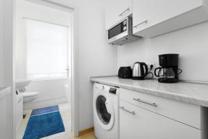 A kitchen or kitchenette at Grand Central Mitte Apartment