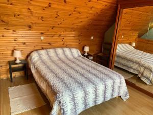 Un ou plusieurs lits dans un hébergement de l'établissement Gîte Chablisien