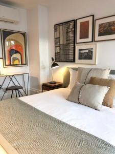 Oporto Chic&Cozy - Aliados tesisinde bir odada yatak veya yataklar