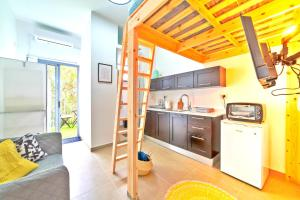 A kitchen or kitchenette at ☀Dawn & Sun☀ Boutique Studio in TLV + Balcony