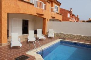 Het zwembad bij of vlak bij Villa Corralejo
