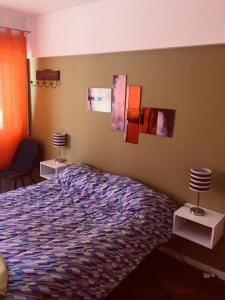 Una cama o camas en una habitación de DEPARTAMENTO ECONOMICO PLENO CENTRO