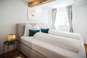 Ein Bett oder Betten in einem Zimmer der Unterkunft Exclusive Apartment Il sogno di Scipione