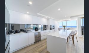 A kitchen or kitchenette at The Penthouses Beachfront Penthouse 45