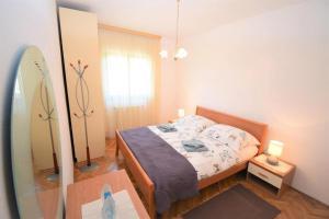 Ein Bett oder Betten in einem Zimmer der Unterkunft Apartment Vita
