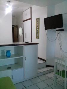 A television and/or entertainment centre at Flats na Barra