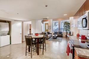 A restaurant or other place to eat at 3BR/1BA Stunner in Center Of Gaslamp!