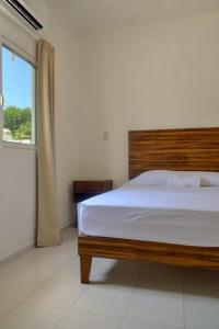 Ein Bett oder Betten in einem Zimmer der Unterkunft Casa Central
