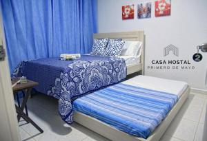 A bed or beds in a room at Casa hostal primero de mayo