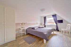 Ein Bett oder Betten in einem Zimmer der Unterkunft Ferienwohnung Zollstraße 2. Etage