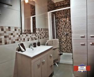 Um banheiro em Casa Família Cardoso