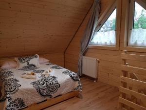 """Łóżko lub łóżka w pokoju w obiekcie Apartamenty """"Pod Tatrami"""""""