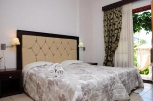 A bed or beds in a room at Villa Panagiota