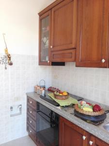 A kitchen or kitchenette at Casa della camperia