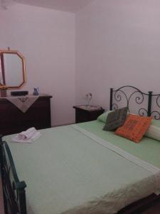 A bed or beds in a room at Casa della camperia