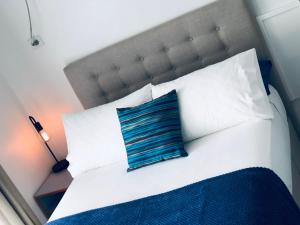 A bed or beds in a room at Absolute Oceanfront Suite