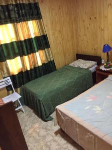 Una cama o camas en una habitación de CABAÑAS LOS JESUITAS