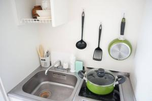 A kitchen or kitchenette at Apartment in Nagoya SS1B