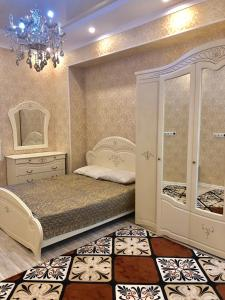 A bed or beds in a room at Ak Bars Residence