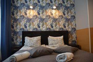 En eller flere senge i et værelse på B&B La Fontaine