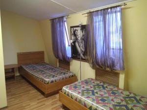 A bed or beds in a room at СЕРЕНАДА