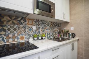 A kitchen or kitchenette at Apartamento do Castelo