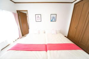 A bed or beds in a room at Awaji Seaside Resort in Iwaya 3000