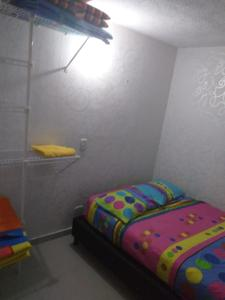 A bed or beds in a room at Medellin for you