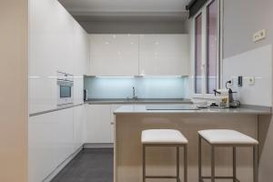 A kitchen or kitchenette at Downtown by Forever Rentals