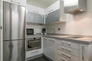 A kitchen or kitchenette at Paseo Arenal by Forever Rentals