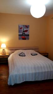 Un ou plusieurs lits dans un hébergement de l'établissement Maison 6 Personnes Épernay