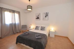 Cama o camas de una habitación en Villa Deluxe Island Golf and Beach by Sea You There Fuerteventura