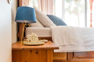 A bed or beds in a room at Poseidon's Luxury Apartment