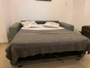 מיטה או מיטות בחדר ב-טל רזידנס