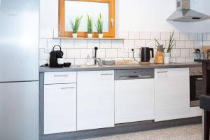 A kitchen or kitchenette at dreamlike APARTMENT