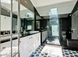 A kitchen or kitchenette at Plush Greenery Mediterranean House with Jacuzzi
