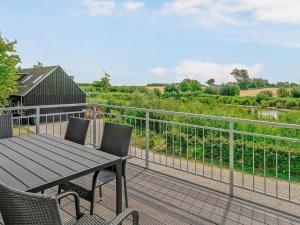A balcony or terrace at Three-Bedroom Holiday home in Åfarnes