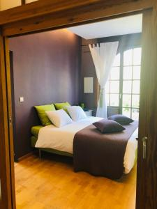 En eller flere senge i et værelse på Apartment Easyway to sleep